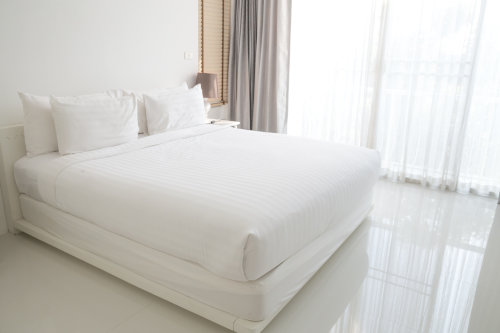 How To Make a Bed With a Mattress Topper