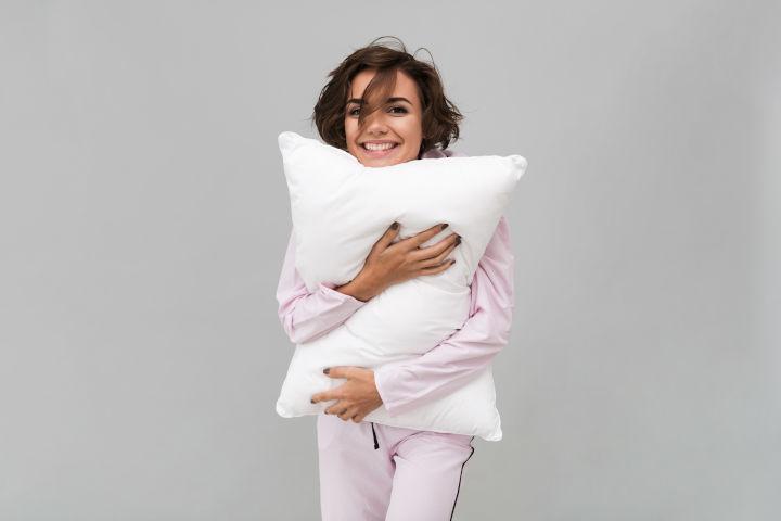 girl holding a pillow
